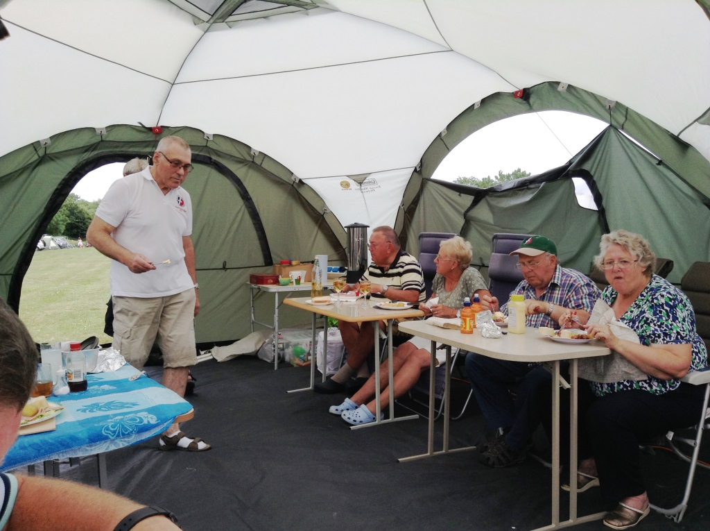 17. A group meal in the party tent